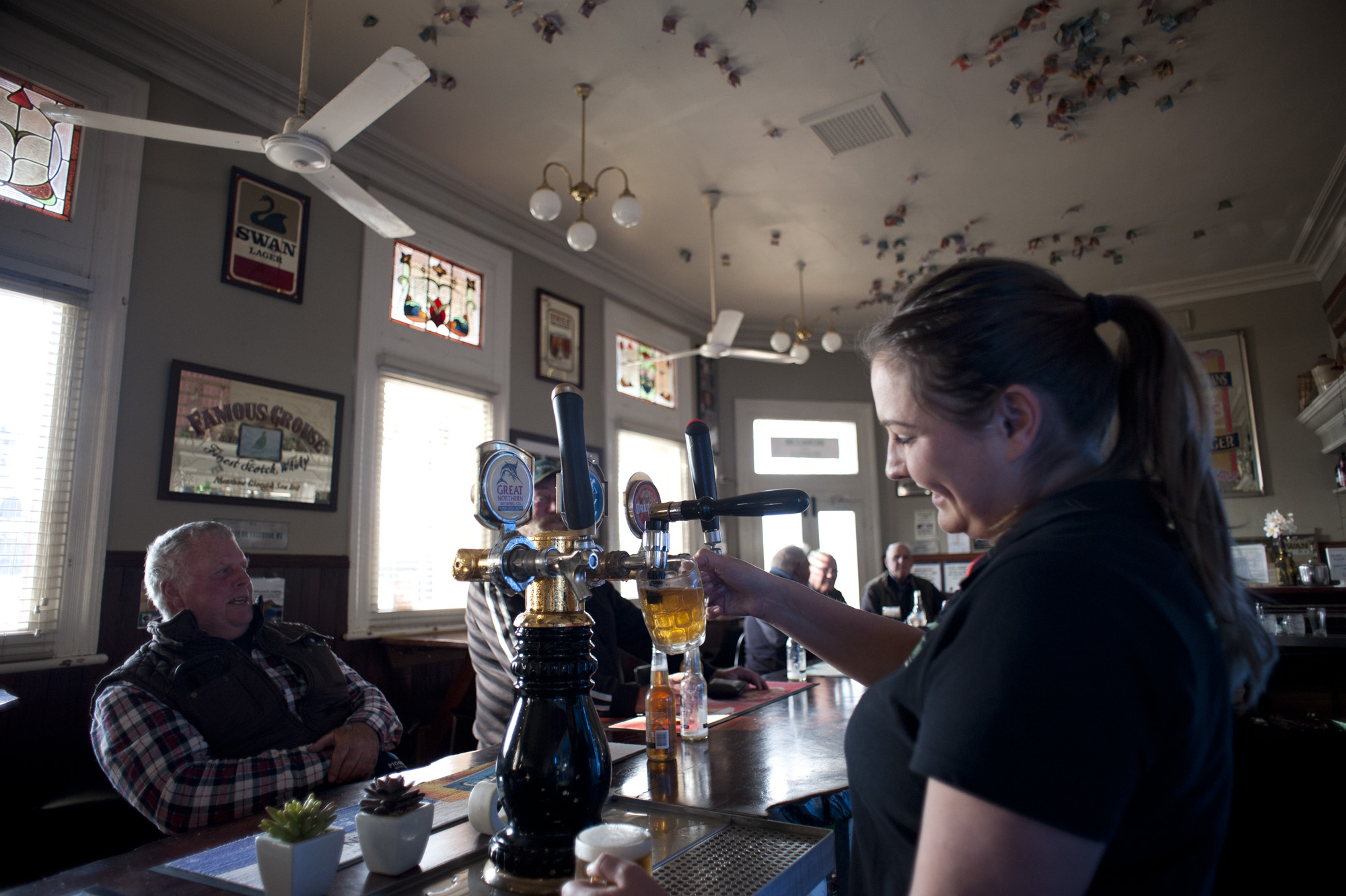 bar maid RiaAnne pouring beers.jpg