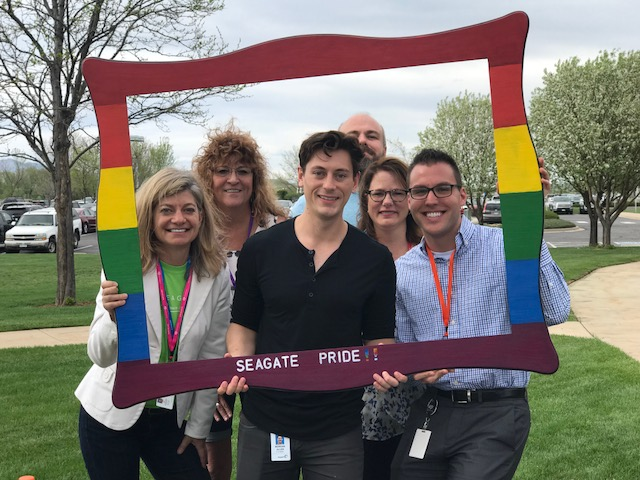 (Pictured: Amy Zuckerman, Shawna Callison, Morgan Allen Co-Chair of Seagate Pride's Longmont Chapter, Ross Thomas, Sheila Phillips, and Ian Waltman Chair of Seagate Pride's Longmont Chapter)
