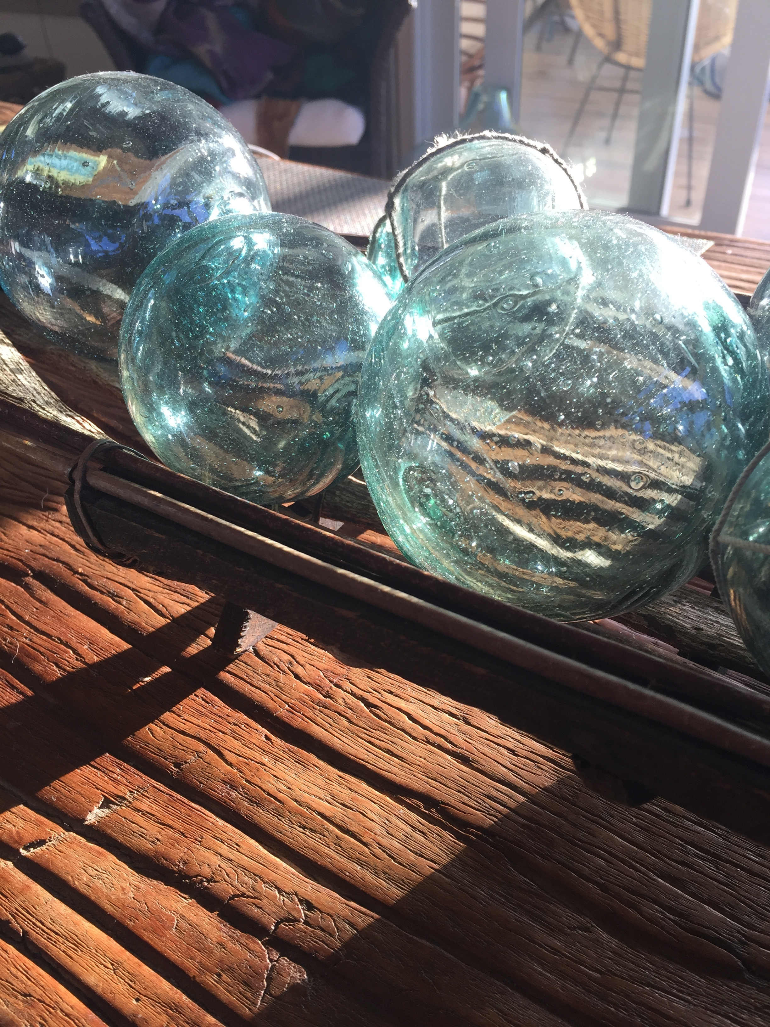 glass floats glowing in the sunlight