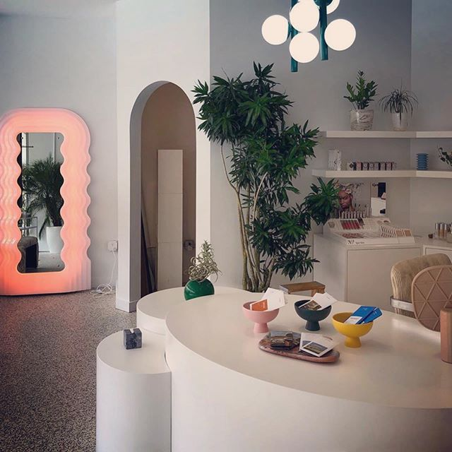 "I've had so many questions about the shop mirror, so I thought it deserved it's own post. A true work of art, the Ultrafragola mirror (which translates ""ultra strawberry"") was designed by Ettore Sottsass and produced in Italy by Pottronova in 1970 and is still in production. The designer was inspired by the curves of women and long waivy hair. It brings me so much joy to have it in the shop, and I've loved the conversations that it sparks. Come take a selfie 🍓🍓"