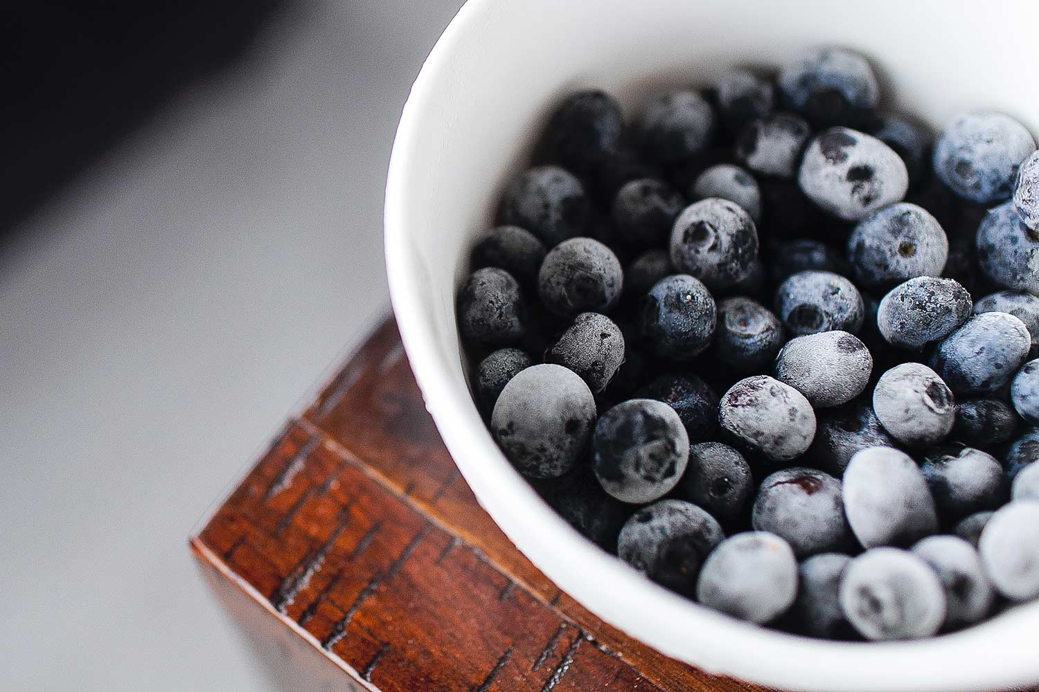 bowl of frozen blueberries to boost vitamin C