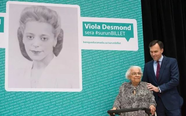 Viola Desmond's sister Wanda Robson with Canada's Minister of Finance Bill Morneau - via lpress.com