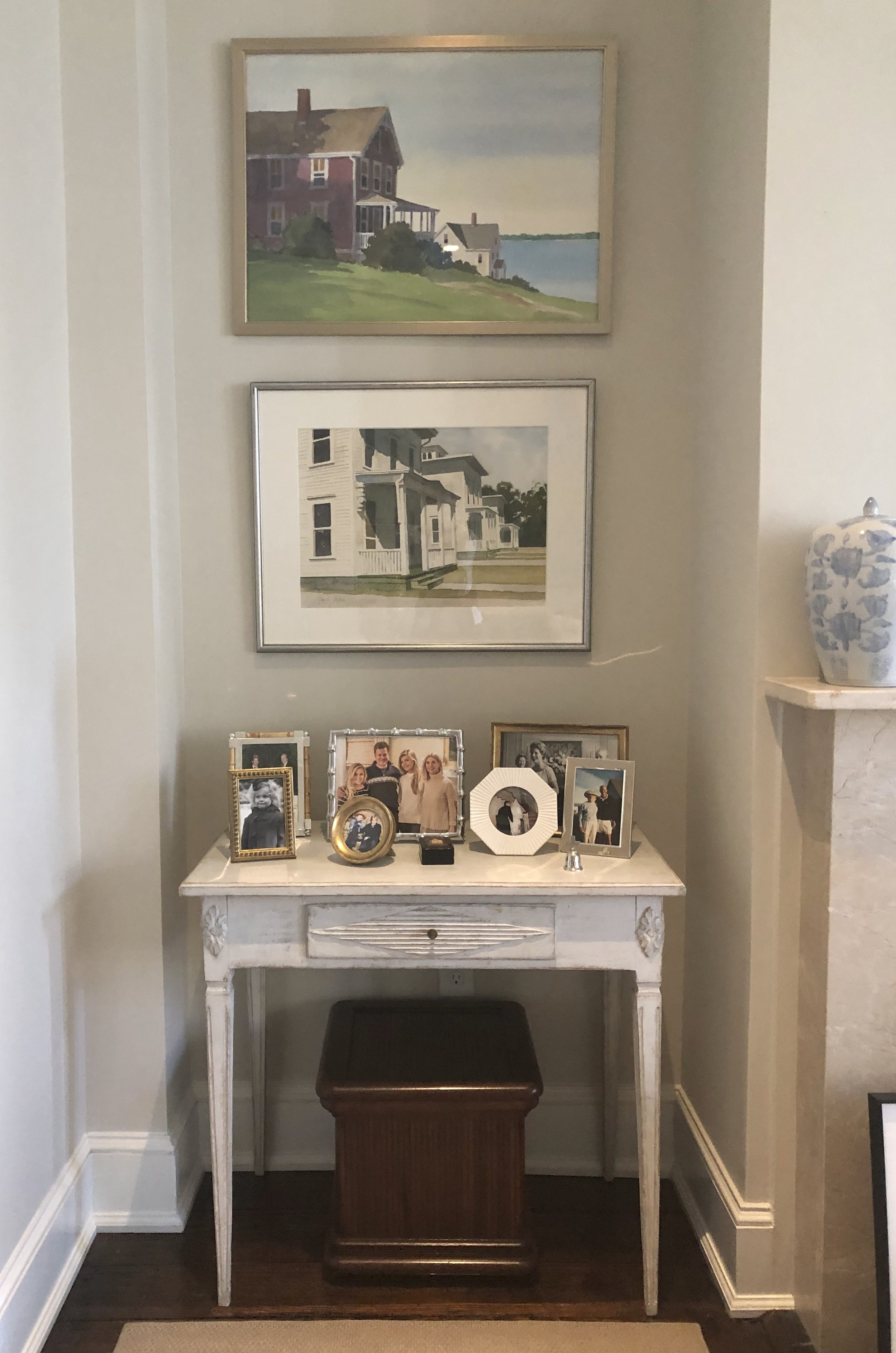 My FAVORITE piece of furniture (perhaps I've shown you before?), the Swedish table above, which I bought from Loi — mixed in with paintings by my dad, framed more simply than usual, plus mix of family photos, old and new….