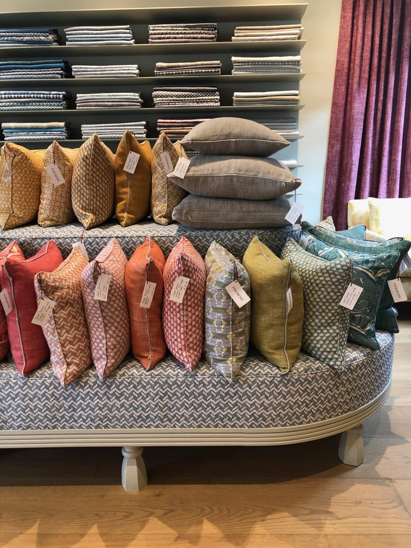 """Fermoie offers fabrics by the yard, pillows (or as they say """"cushions""""), & lampshades."""