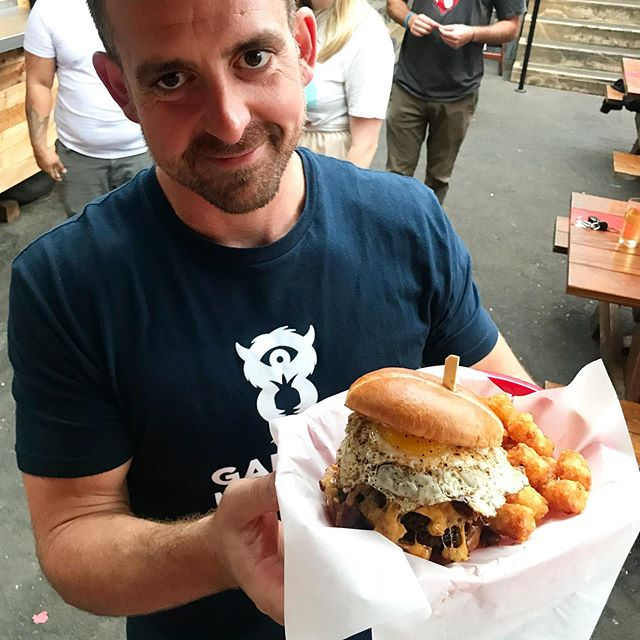 😩💕How cute does this man look holding a double patty brunch burger?! See that bicep? That's from lifting our food to his mouth. @gardenmonsters . . . . #gardenmonsterspdx #thedoghousepdx #portlandfood #portlandfoodcarts #pdx #portland #burger #egg #avocado #bacon #cheese #foodfamily #tots #eatlocal #pdxeats #eaterpdx #giftcards #foodfeed #feedfeed #brunch #supportsmallbusiness
