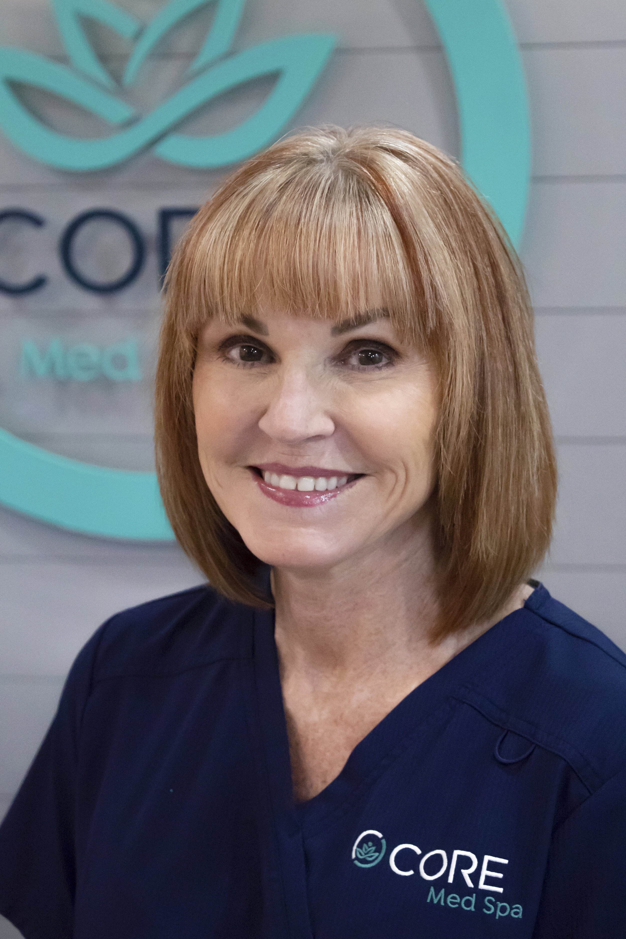 """ELAINE - """"I am a lifelong resident of southern Illinois, and have always been intrigued by cosmetic surgery. I have a Bachelors Degree in nursing and began my career in Plastic Surgery in 1987. Seeing the wave of the future, I wanted to advance my aesthetics knowledge and became a certified nurse injector 10 years ago. I specialize in Botox and dermal fillers and also perform medical grade peels.""""""""Making my patients feel confident about their appearance is my passion. I am a perfectionist and strive to give my patients the best result possible. Injectables are a way to make patients look refreshed and delay the signs of aging without the need for invasive procedures. I am beyond excited to bring my expertise to Core Med Spa."""""""
