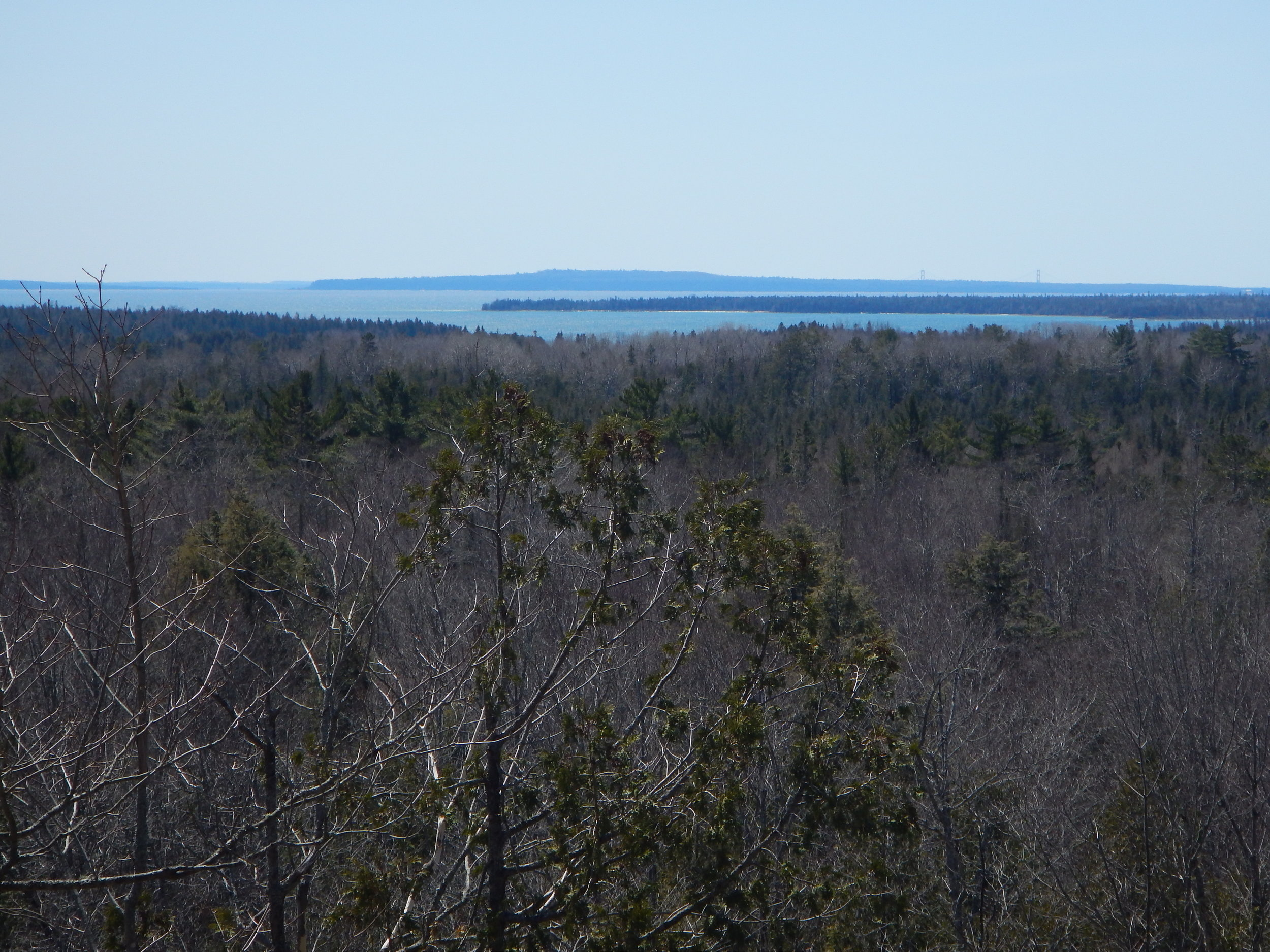 View of Mackinac Island, The Mackinac Bridge and The West Entrance from the top of Peekaboo Hill.