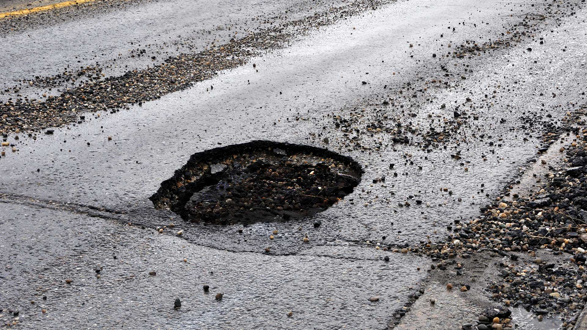 Nicollet-Avenue-Pothole-Discovered-to-Be-Direct-Route-to-Earths-Core.jpg