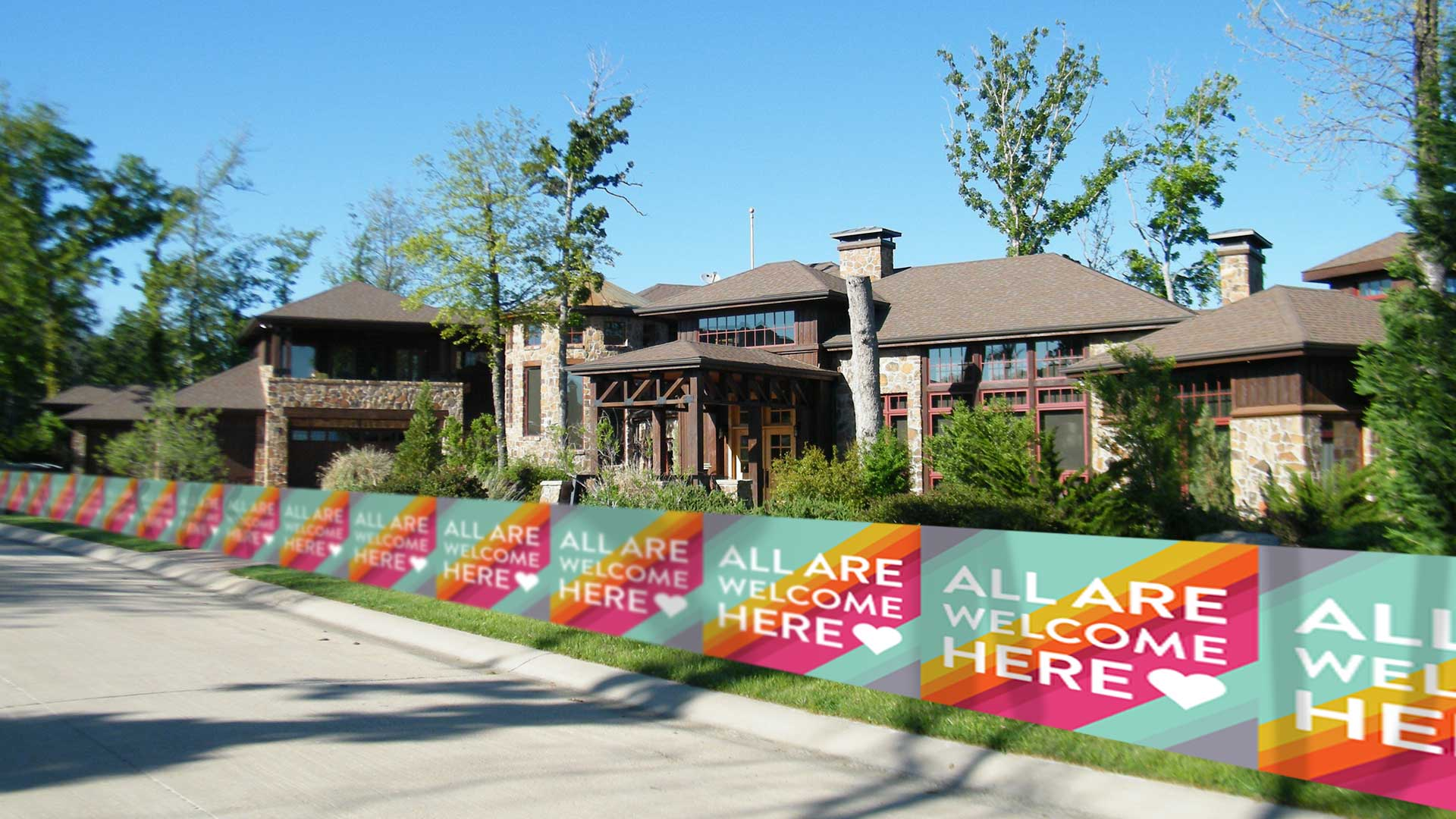 Longfellow-Residents-Invest-in-Single,-Mile-Long-All-Are-Welcome-Here-Lawn-Sign.jpg