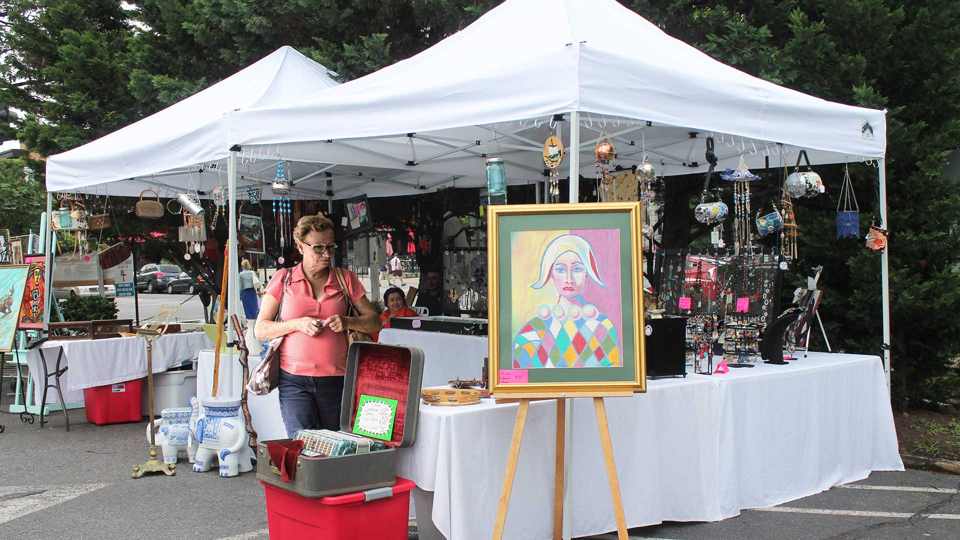 Uptown-Art-Festival-Attendee-Makes-a-Beeline-for-the-Wind-Chimes.jpg