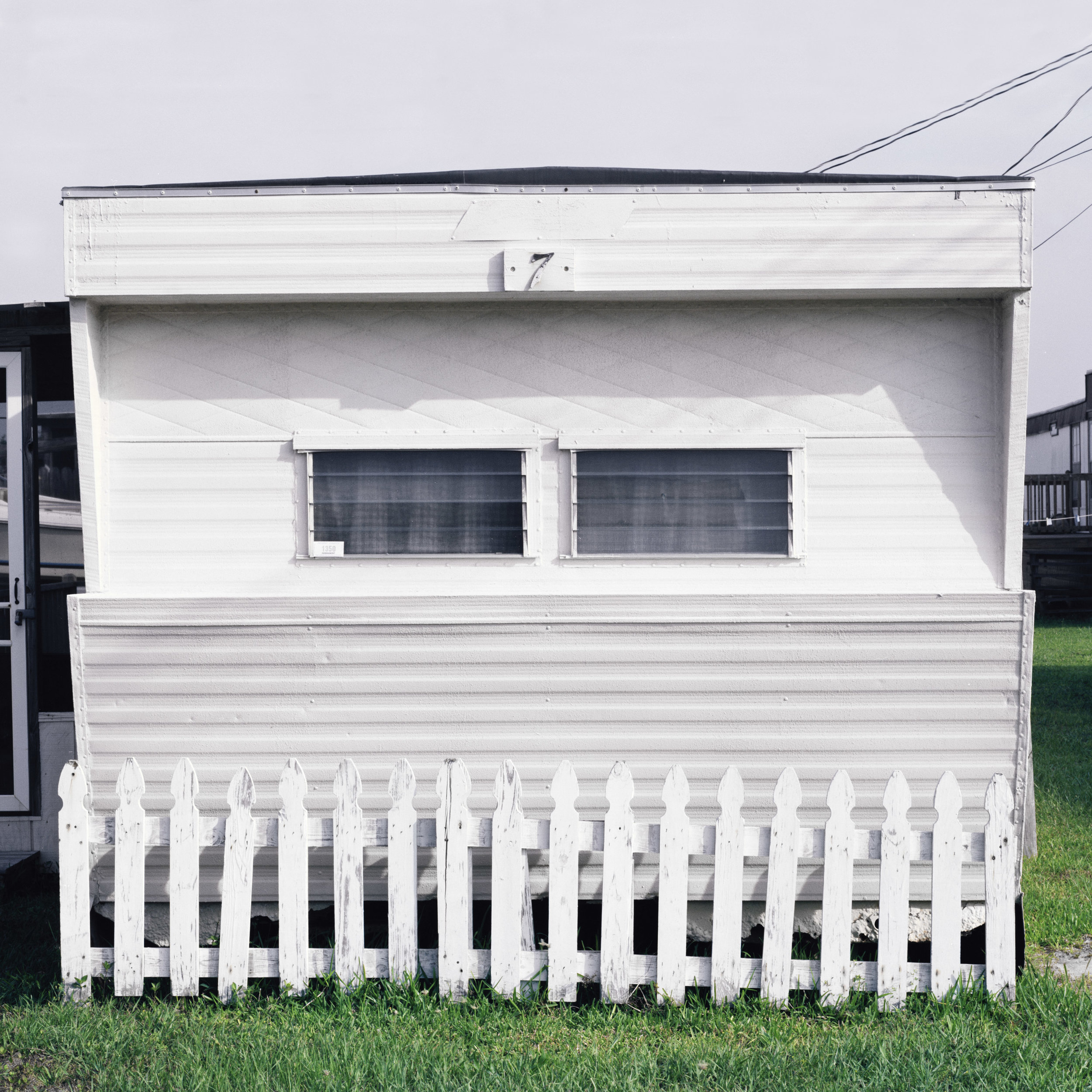 Mobile-Home-White-FenceSquare.jpg