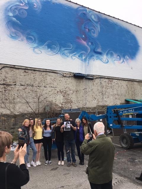 Mr Cenz holding a photo of Matt Dillon along with the Dillon family