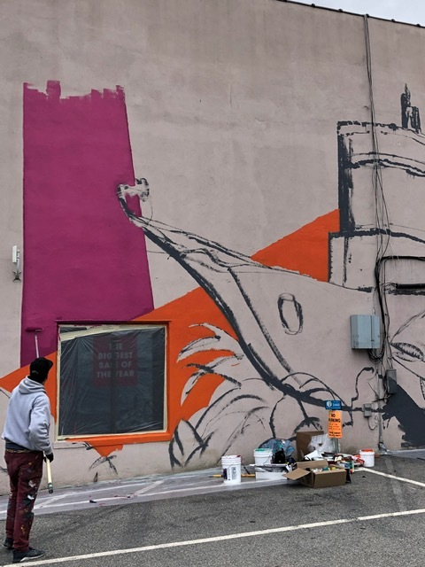 Bruno Smoky in the process of painting his mural