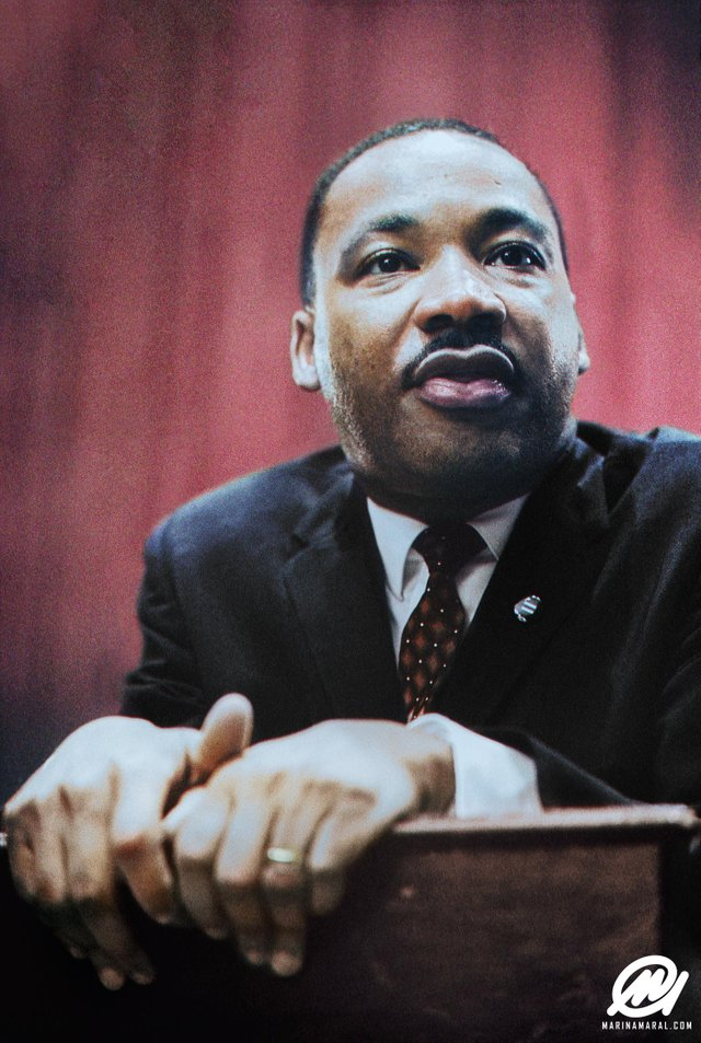 Photograph of Martin Luther King Jr. speaking at a press conference in 1964. Colorization by  Marina Amaral