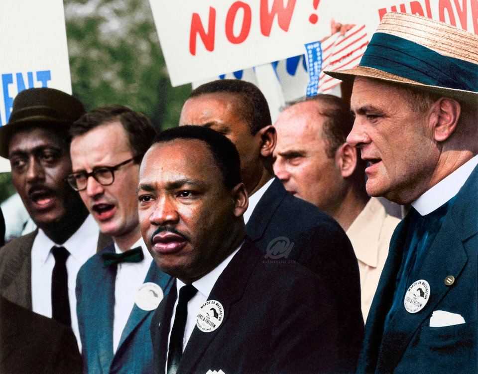 Martin Luther King Jr. in a crowd leading a Civil Rights March on the 28th August 1963. Colorization by  Marina Amaral