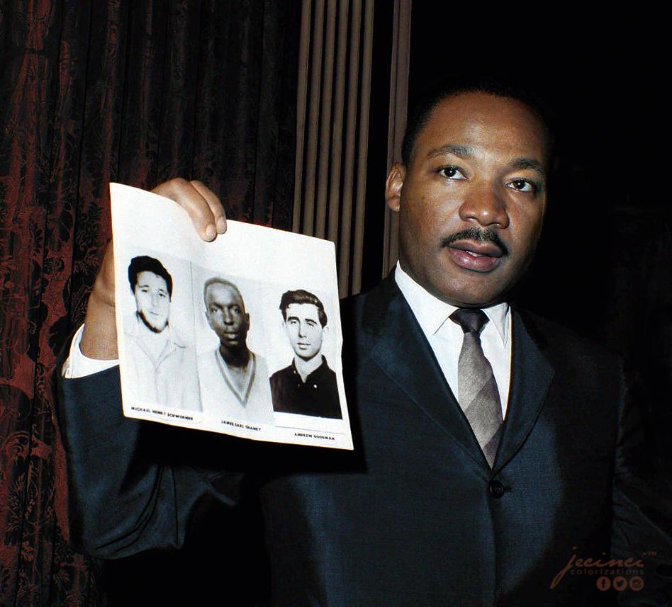 Rev. Martin Luther King holds up photos of the three young civil rights workers murdered in Mississippi. Photograph taken on the 4th December 1964 in New York City, United States. Colorization by  Jecinci
