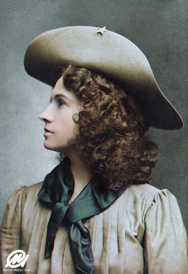 A photograph of Annie Oakley in 1903 at the age of 43. Colorization by  Marina Amaral