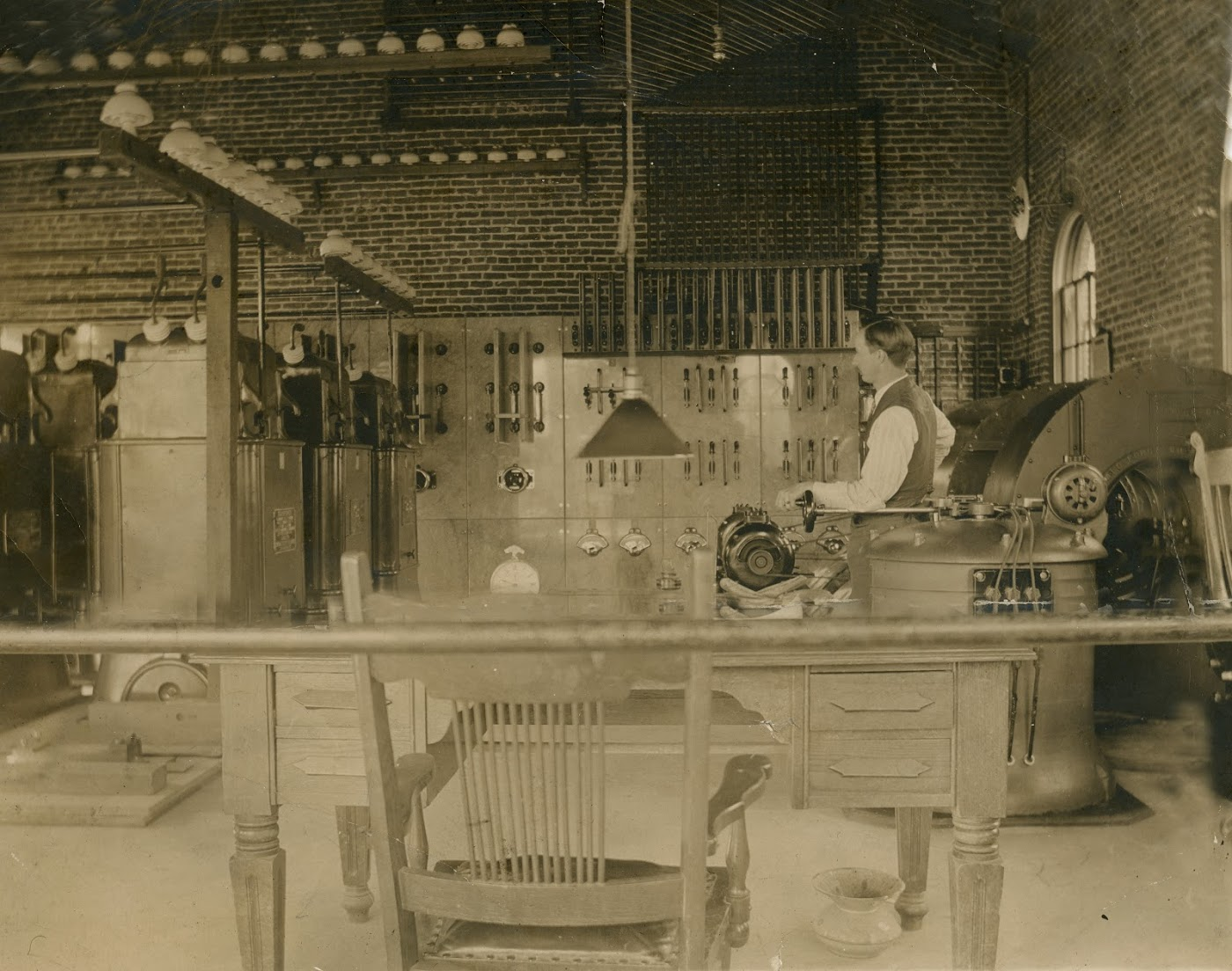 Photo 2318.0016: West Kootenay Power & Light Substation in Rossland, showing electrician William Aldrich hard at work. Date unknown.
