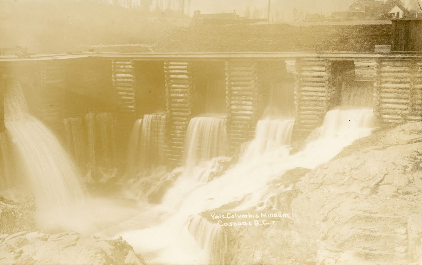 Photo 2318.0022: The Cascade Power House on the Kettle River. This photo was taken in 1920 when the dam was being operated by WKPL.