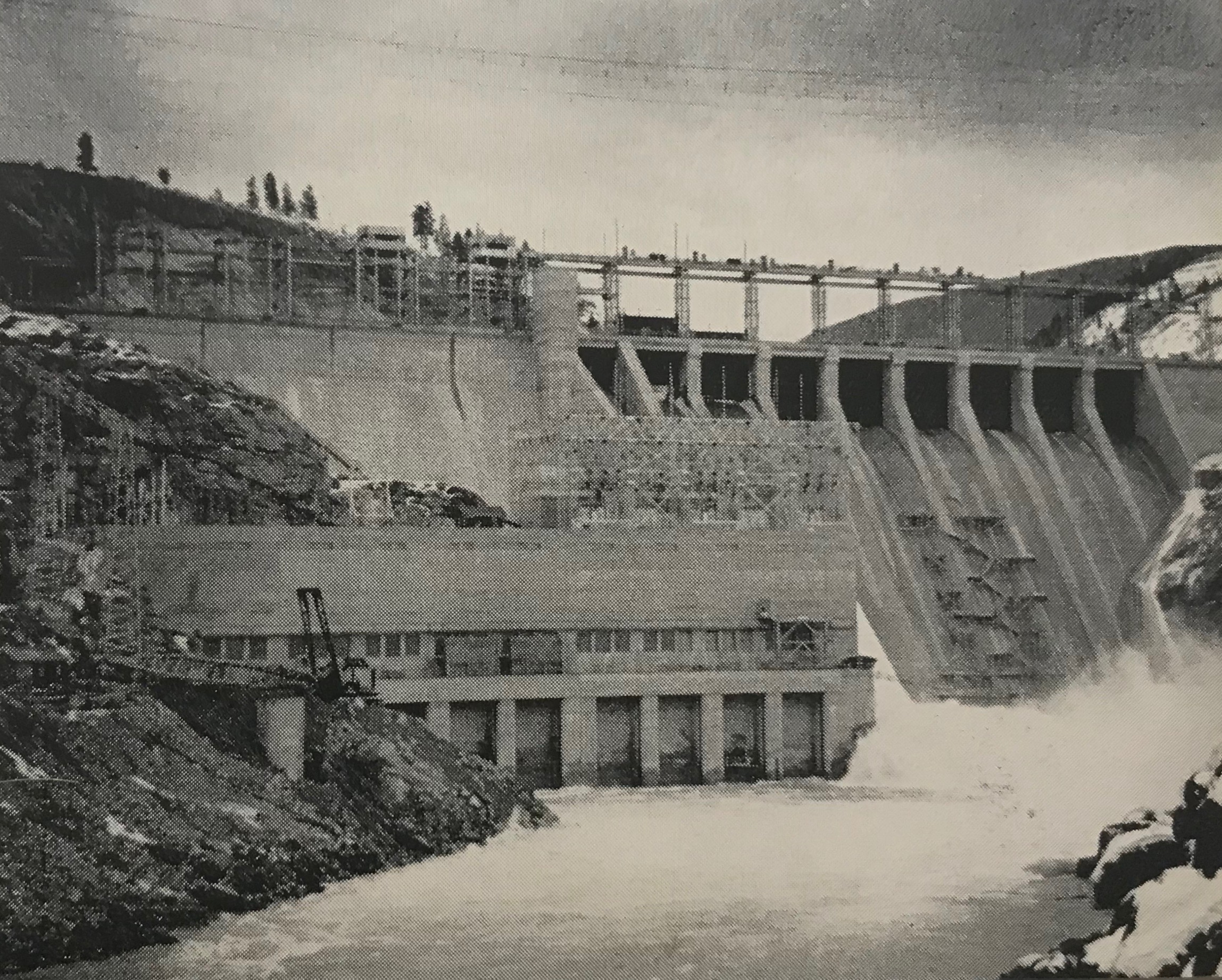 1954:The Waneta Plant - Experiencing a post-war boom, a private CM&S contractor is hired to build a dam on the Pend D'Orielle River, named the Waneta Dam. This dam was first planned in the 1920s with the goal to build the plant in the 1930s. Power lines were even built to the planned site in anticipation of its construction. However, the impact of the Great Depression led to the project being abandoned until the 1950s.This photo, which was published in the April 1954 edition of Cominco Magazine shows the Waneta Dam shortly after becoming operational.