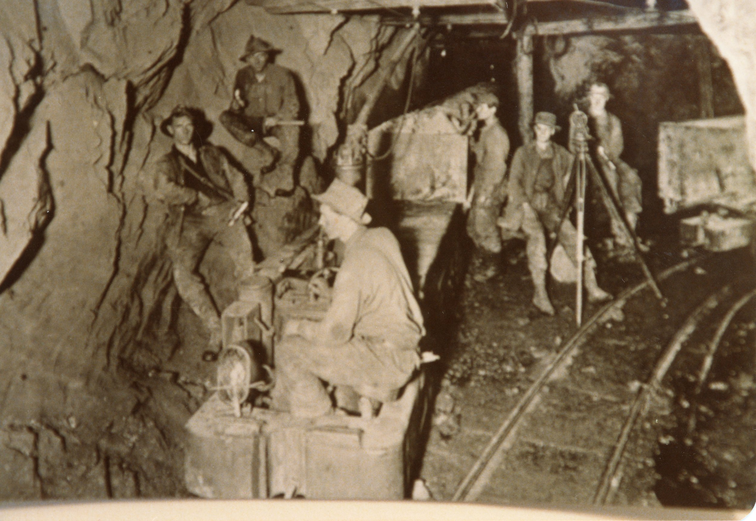 Photo 2304.0126: 1300 ft level in the War Eagle Mine, showing the electric tram track. 1913; Names unknown.