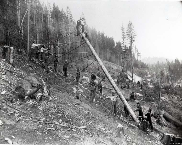 1898:Power To Rossland - On July 15th, 1898, the first light supplied by WKPL reaches Rossland. This was an engineering feat for the time, with 51.5 kilometers (32 miles) of power line having been built between Rossland and Bonnington, a task accomplished in just a year and a day. This was the longest high voltage line to be built in North America!Photo 2318.0047: West Kootenay Power & Light Company workers raising a power pole along the Bonnington to Rossland route in 1897.