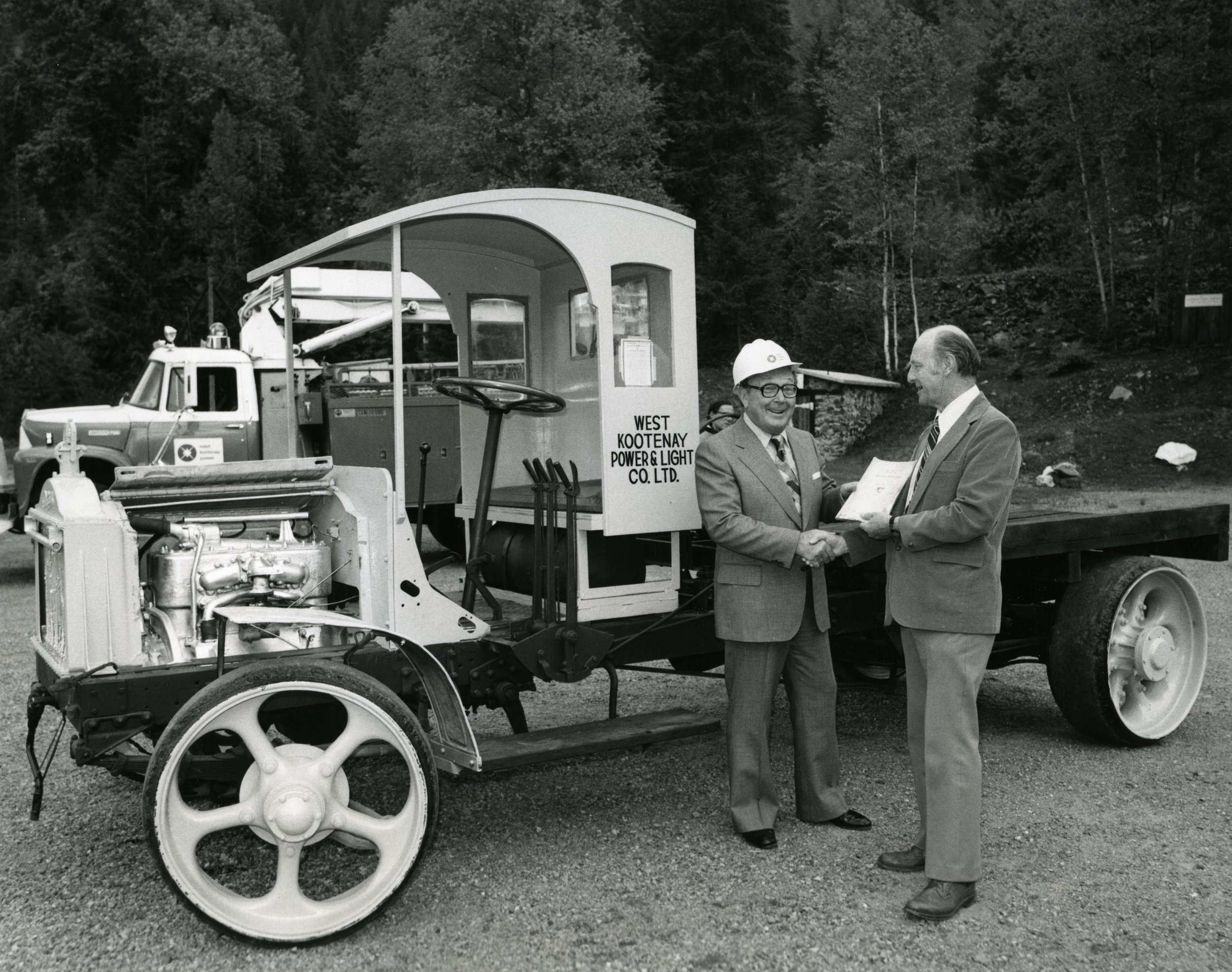 Photo 2276.0179 - not in BI: The presentation of the West Kootenay Power & Light's Packard truck to the Rossland Museum, May 27th, 1976. Pictured on left is F.E. Burnet, the Chairman of the WKP&L board, and on right is J. McDonald, President of the Rossland Historical Museum.