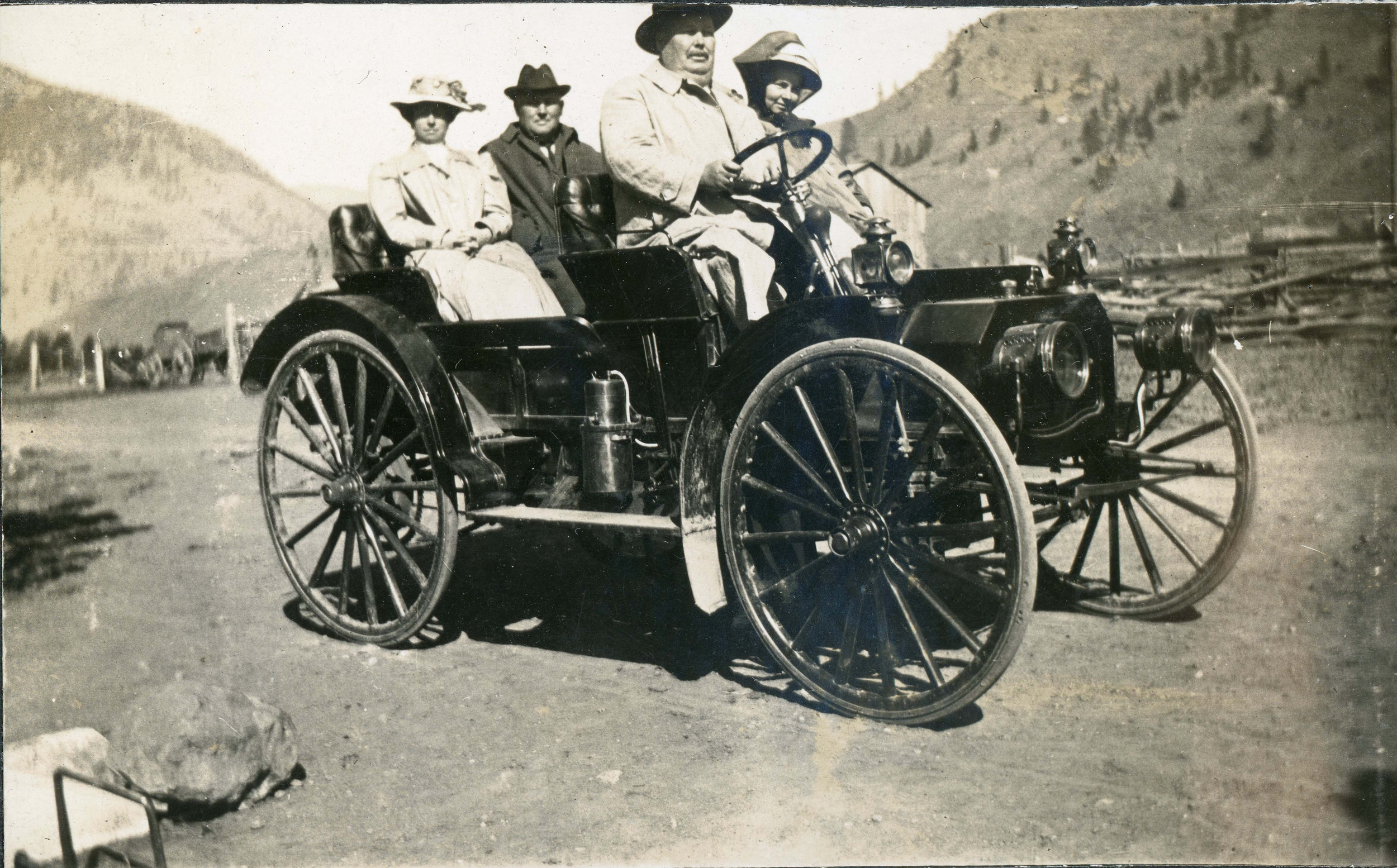 Photo 2337.0078: Two Rossland couples enjoy a ride in an early automobile, circa 1900. Names unknown.