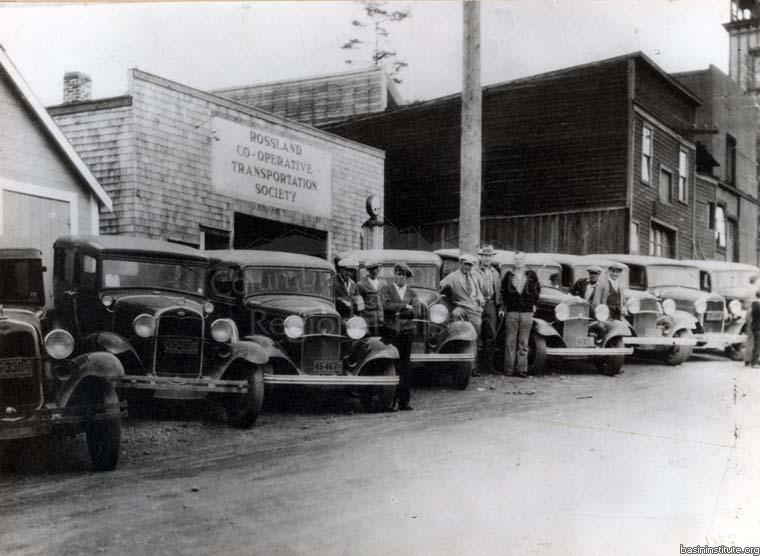 Photo 2318.0051: The Rossland Co-operative Transportation Society's first fleet of automobiles, in 1933.