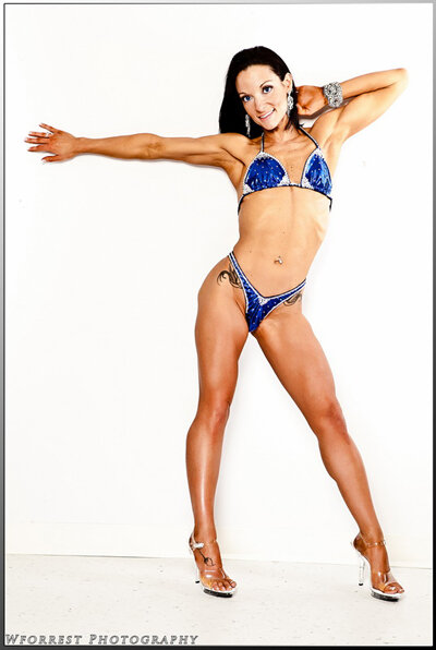 """""""The """"Wicked Abs"""" e-book gave me the guidance I needed to develop a strong and defined core! The workouts programs are challenging and extremely detailed, which made them easy to understand and execute correctly and effectively! This book helped me achieve the """"Wicked Abs""""  I had always dreamed of! """" —Aimee MacDonald, Figure Competitor"""