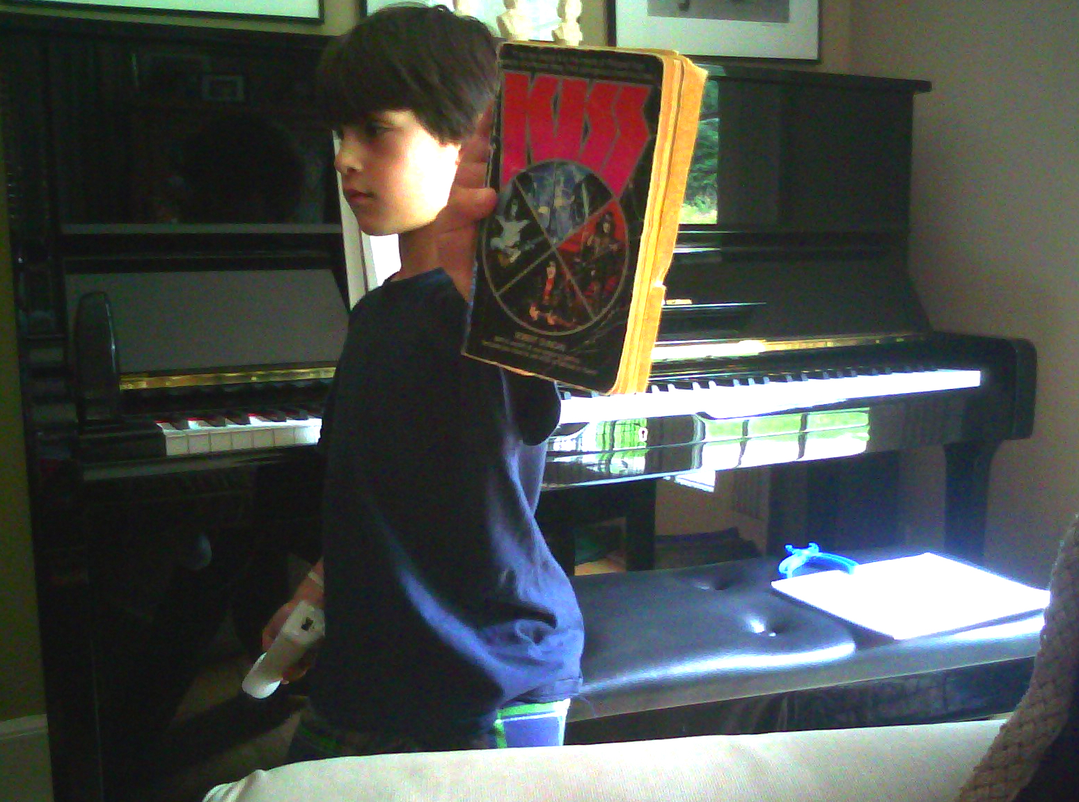 owen york 7 yr old with kiss book from fan_crop.jpg