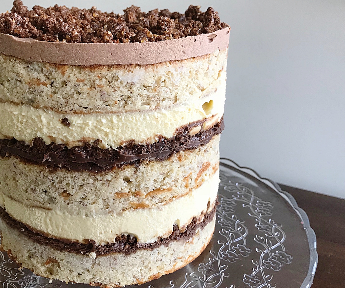 "Banana Hazelnut layer cake - Fluffy buttermilk banana cake, chocolate ganache, banana cream, crunchy hazelnut crumb.5""-6""/13-15cm10-12 serves$75"