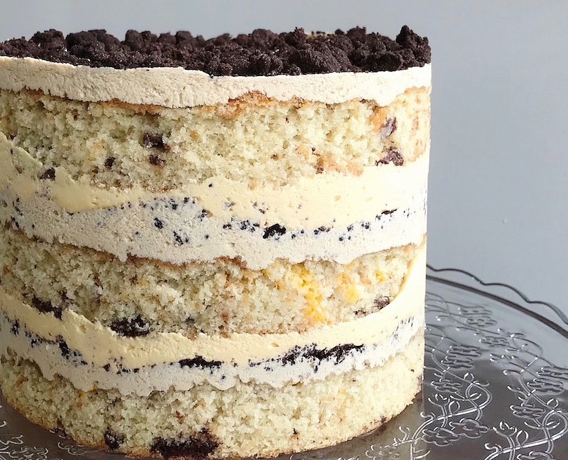 "Passionfruit ChocChip layer cake - Three layers of choc chip sponge, passionfruit cremeux, crunchy chocolate crumb finished with subtle coffee icing.5""-6""/13-15cm tall10-12 serves$75"