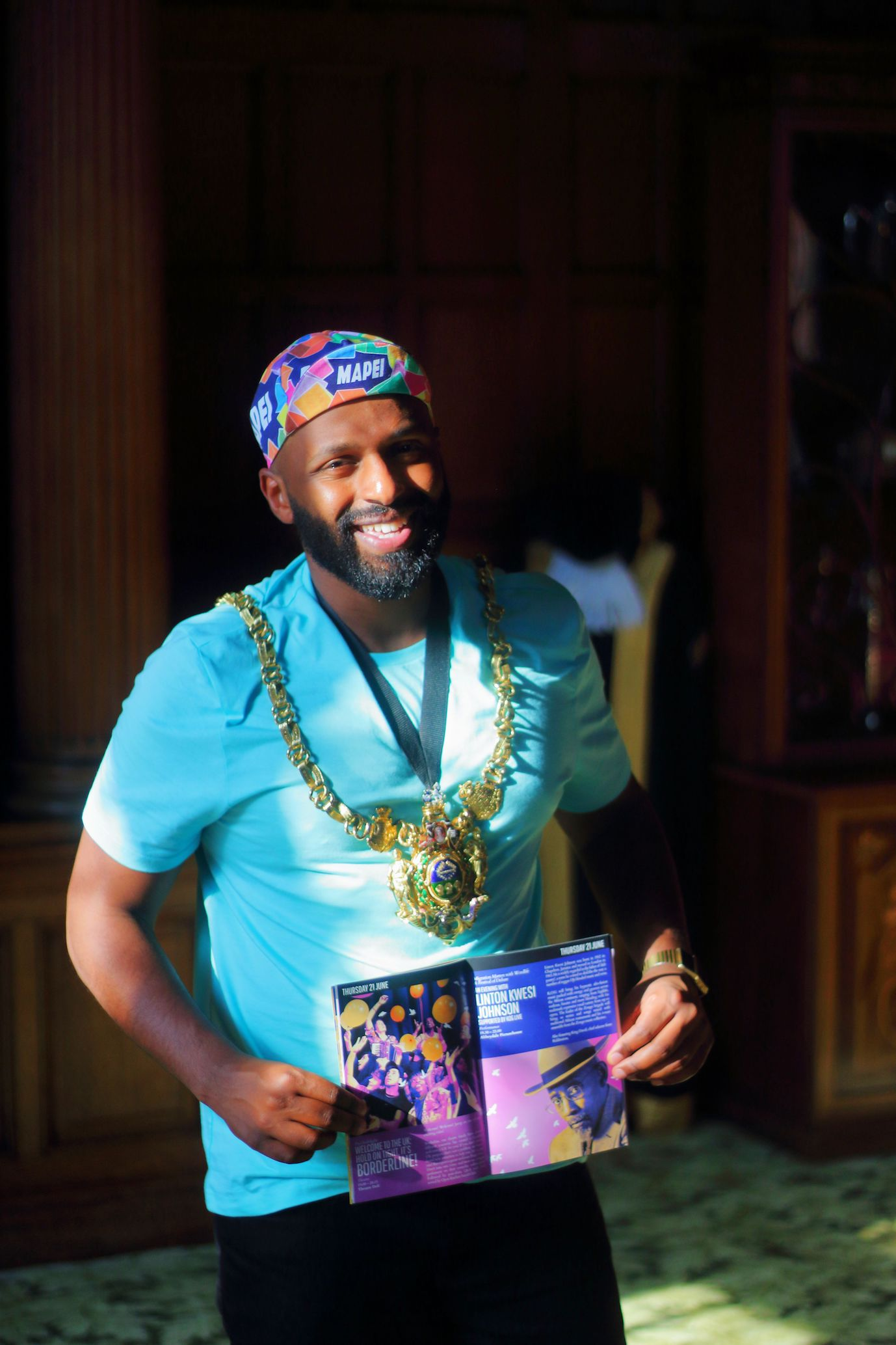 Lord Mayor of Sheffield Magid Magid with the Migration Matters Festival 2018 brochure