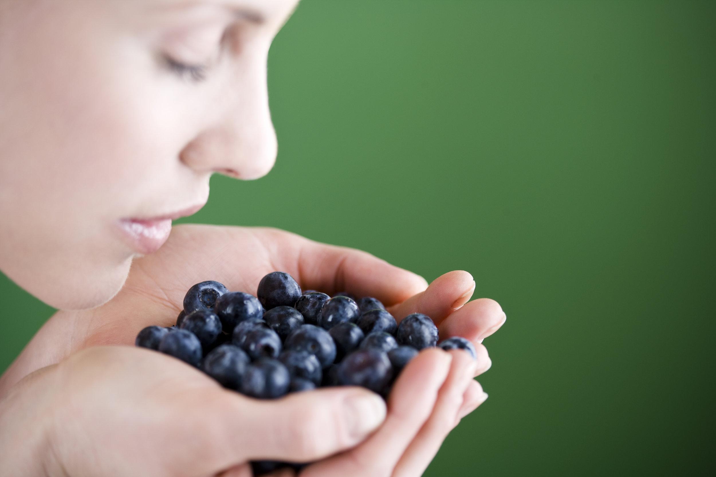 Food Boss Image Woman Enjoying Blueberries.jpg