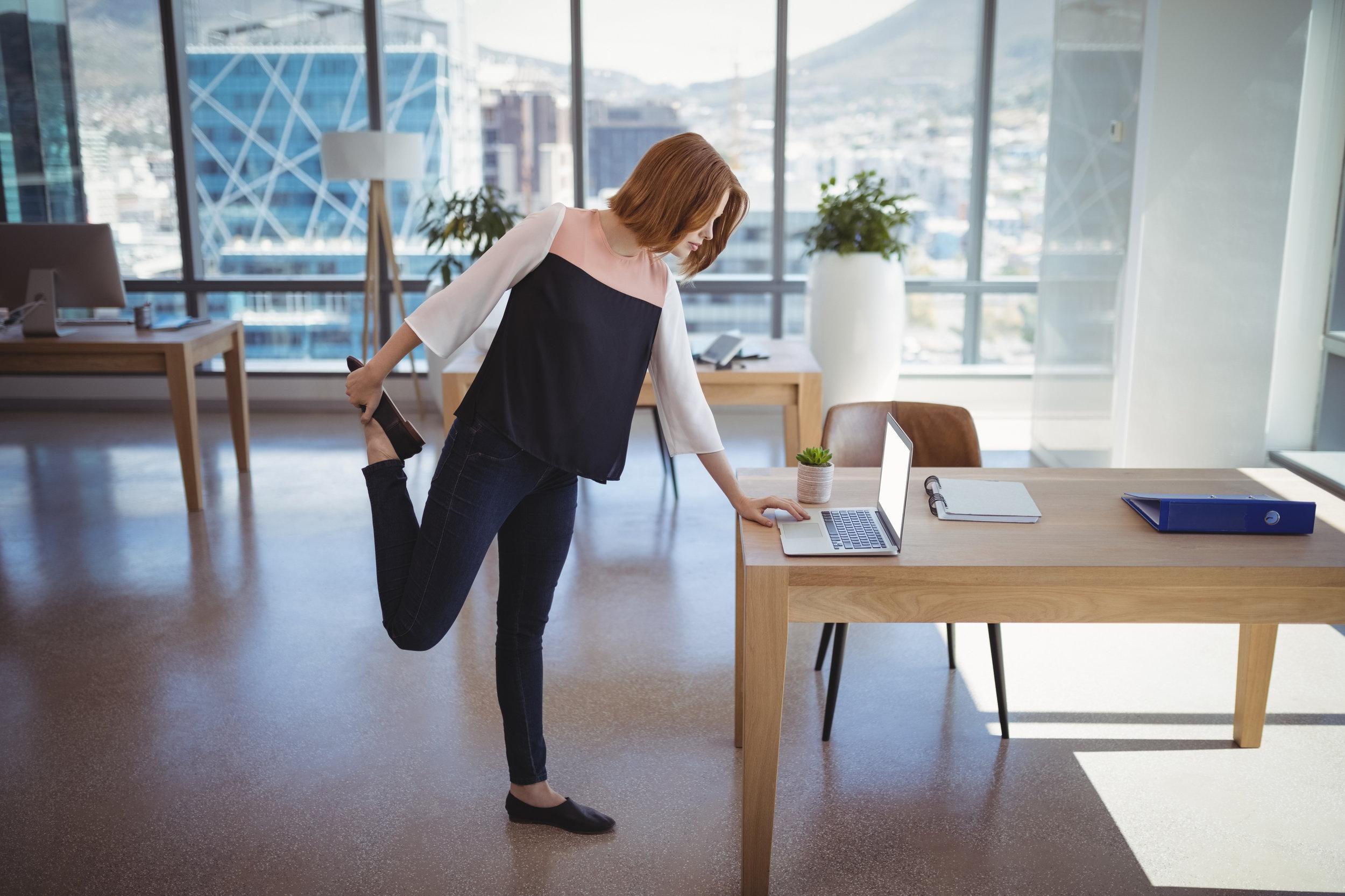 BWFS Image Woman stretching by desk.jpg