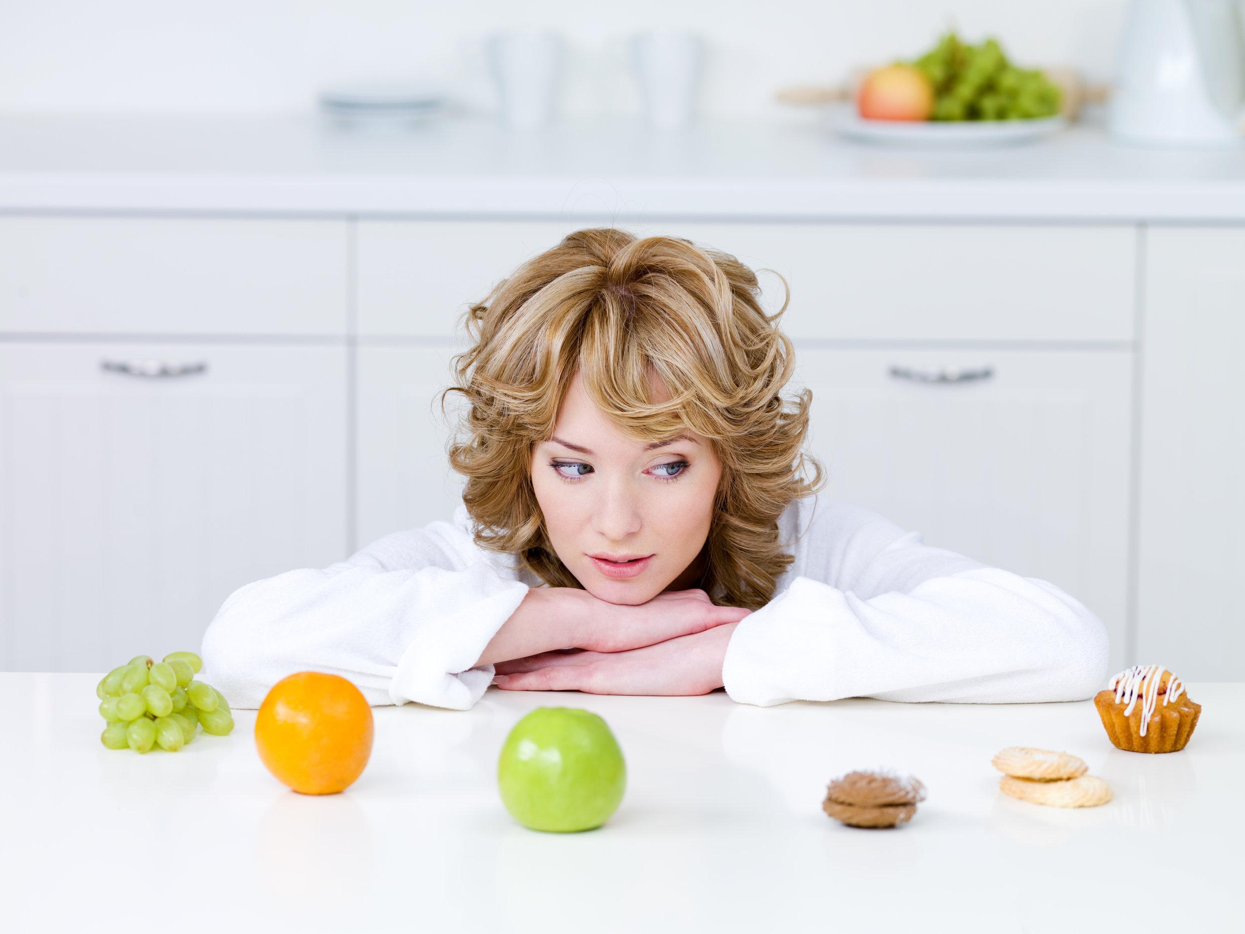 BWFS Image Woman Choosing junk food or fruit.jpg