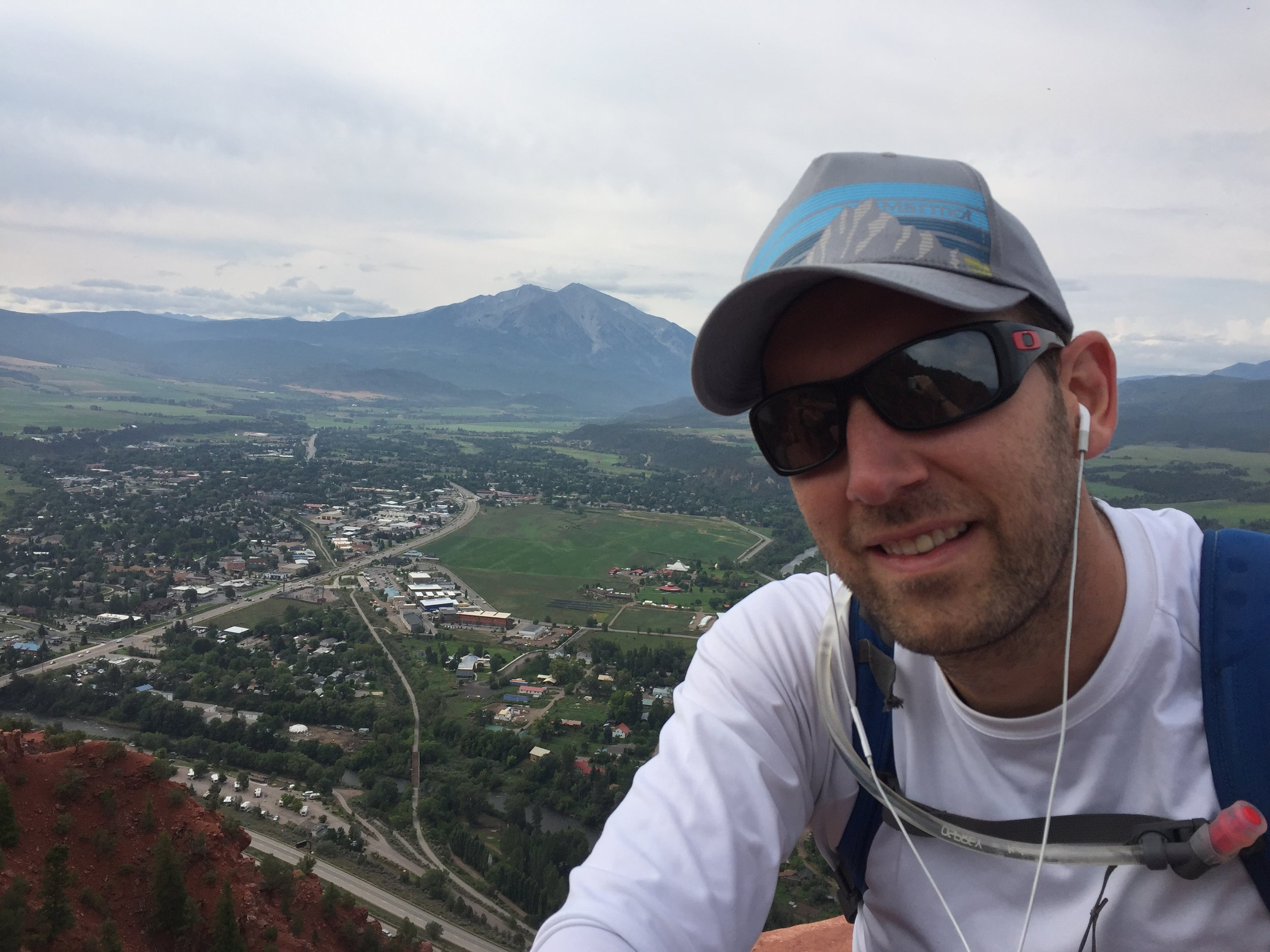 Brett Krudener pictured atop Mushroom Rock with the Town of Carbondale in the background.