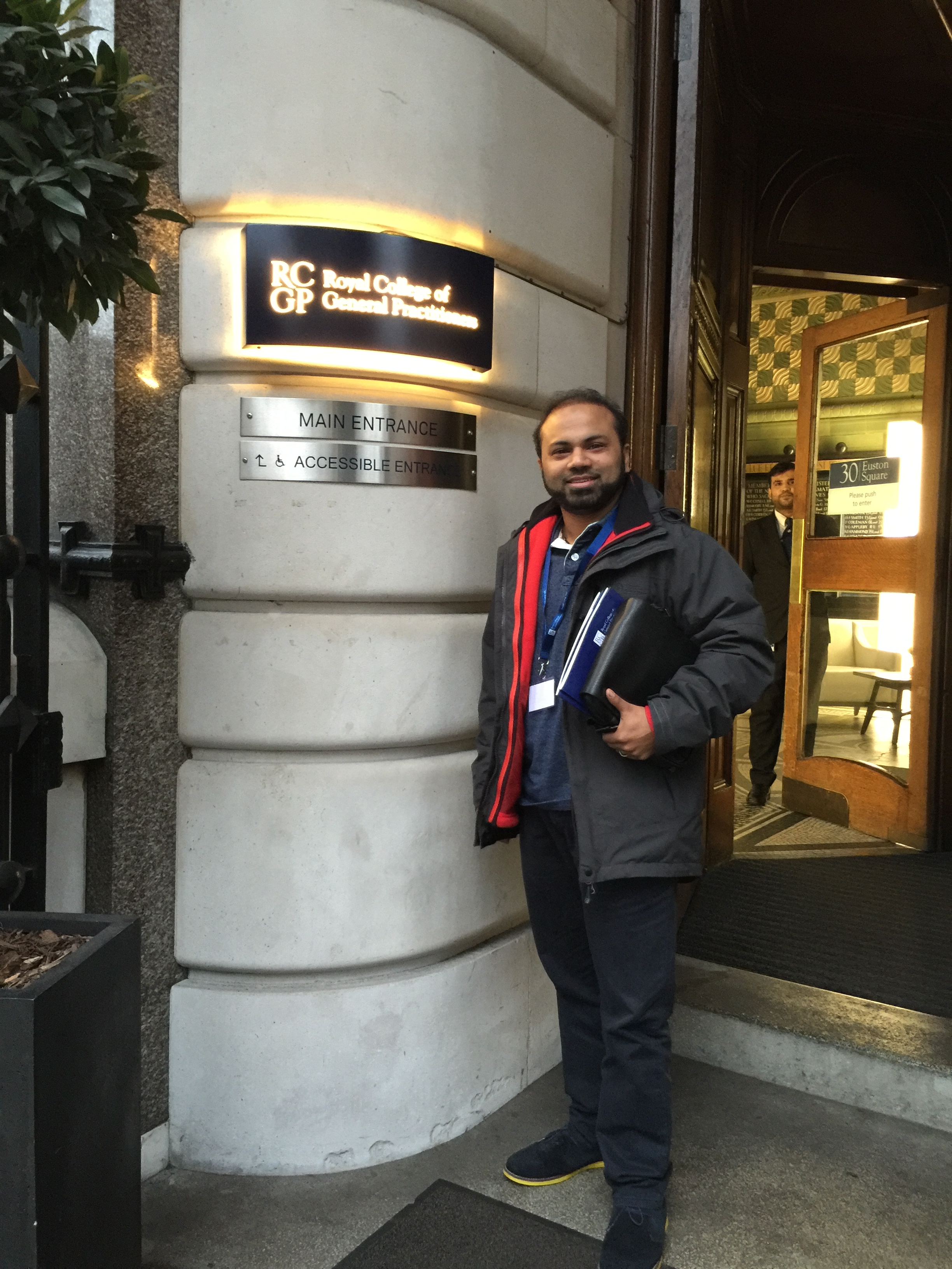 Dr Mannan MRCGP. Attending a GP Training course at the Royal College of General Practitioners.