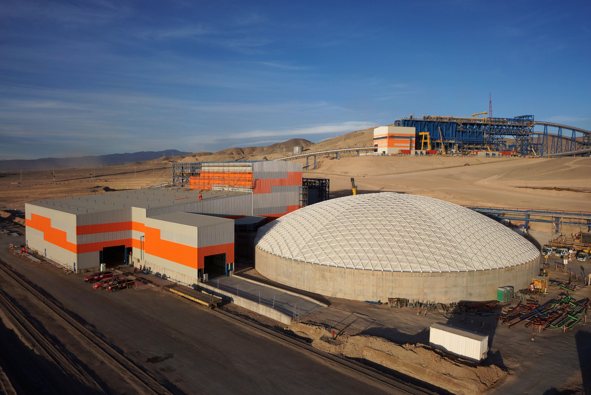 Foreground: a 62m concentrate storage dome. Background: a 122m copper ore storage dome