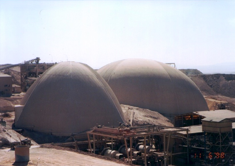 The ore domes of Mantos Blancos exemplify custom design over freestyle piles and include conveyor openings, vehicle openings, canopies and machinery at this mining complex.