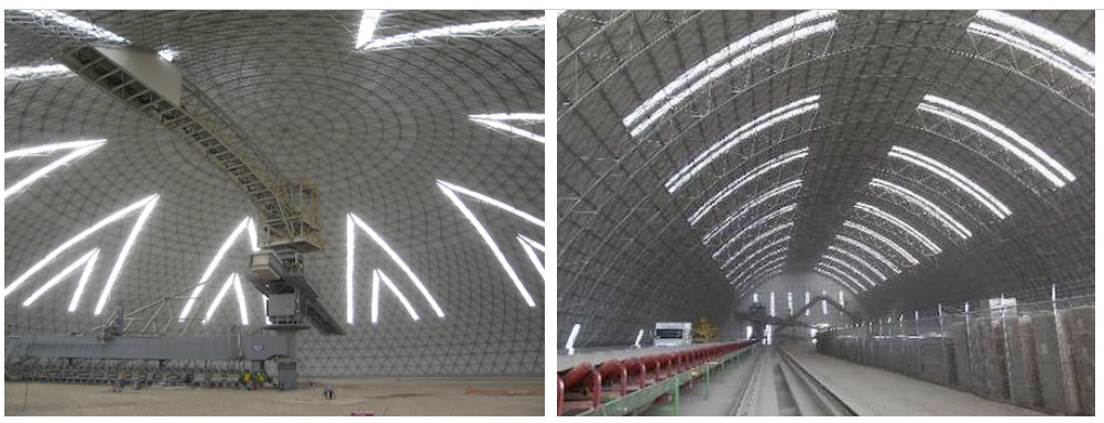 Vista interior de dos domos, uno de 51m para almacenamiento de carbón, y otro de 104m para almacenamiento de caliza, ambos en Polysius Palmafa, demuestran un diseño personalizado que cumple con necesidades de almacenaje específicas.