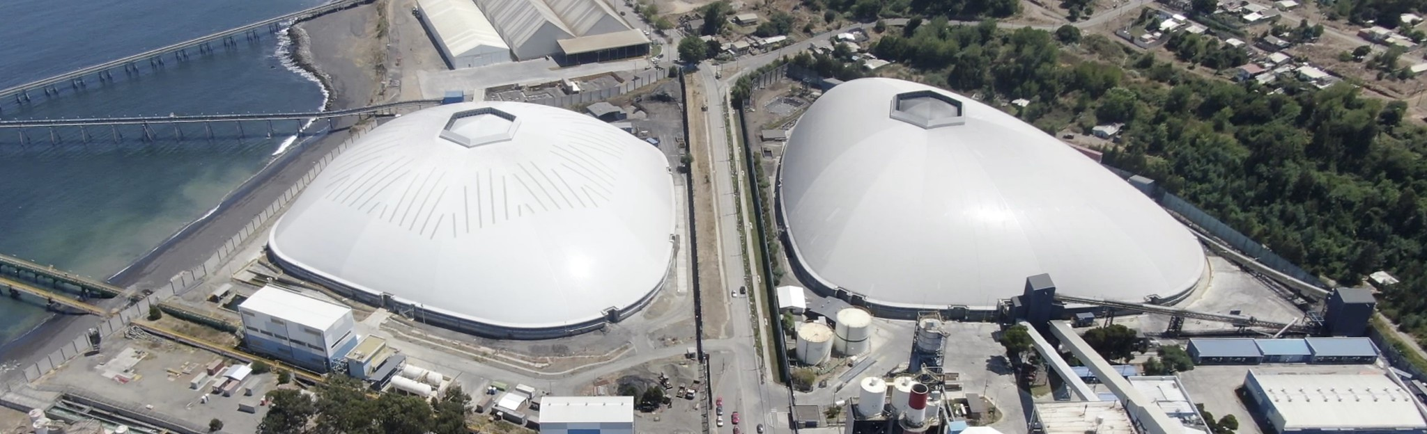 Two free-form domes to cover coal stockpiles in Bocamina, Chile.