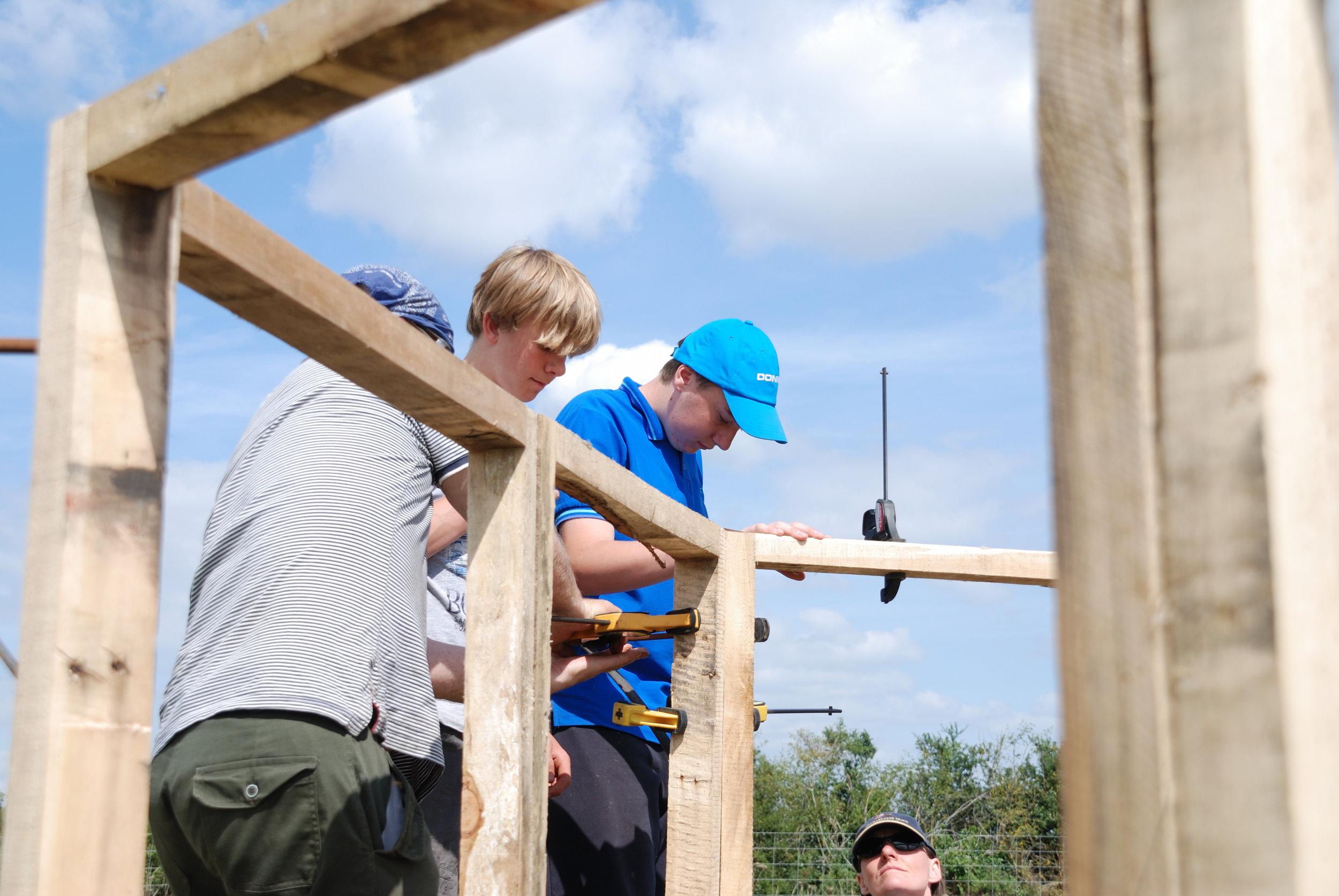 2013 NCS volunteers design and build woodland shelter.JPG