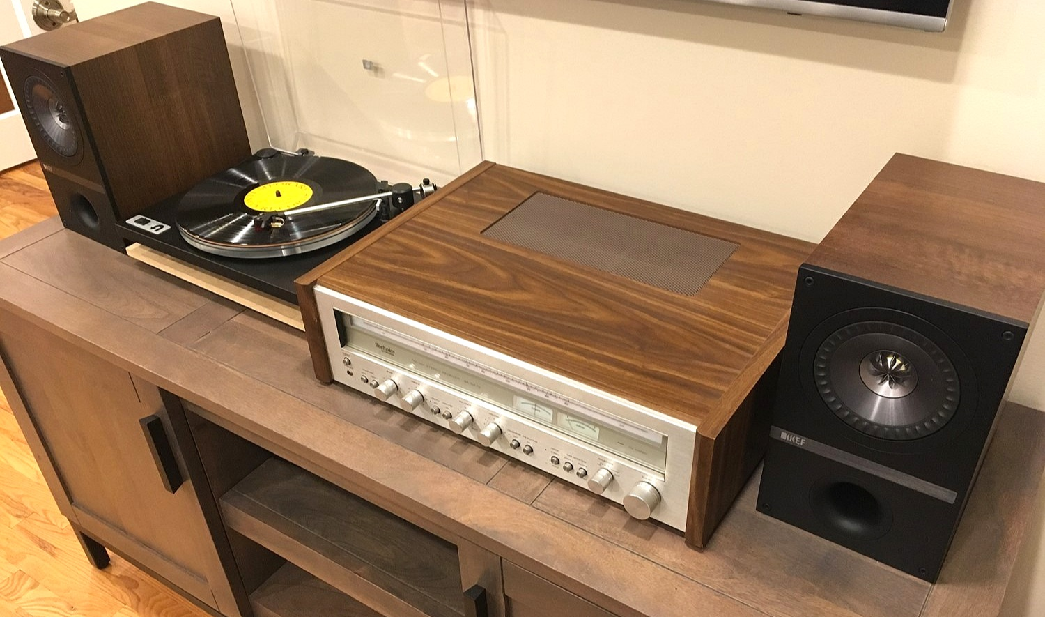 A modern vintage hybrid setup with a late 70's Technics receiver paired with a modern U-Turn Orbit and pair of KEF Q100 speakers