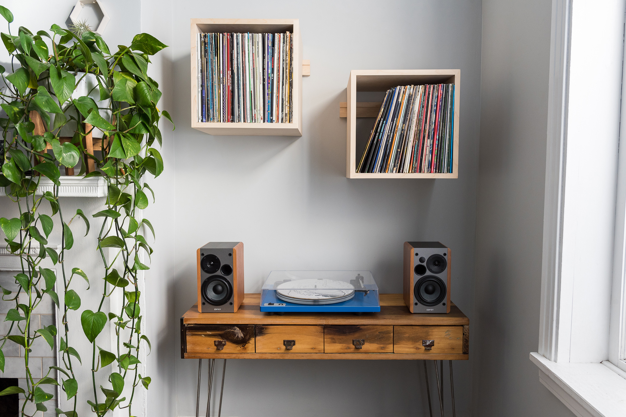We designed and made our wall-mounted cube shelves and record display racks because we think they are the best.