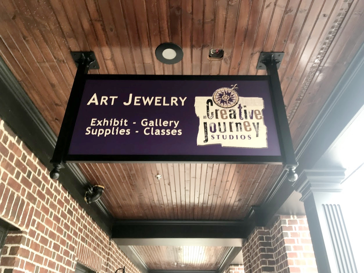 Custom Fabricated Metal Signs - Our custom fabricated sign frames and hanging arms are super elegant!