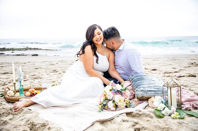 MY HEART IS SO FULL!! How gorgeous are Noelle and Juan? And this whole session just makes me happy because it comes with the best story! ✨ . When I started planning this shoot, I posted on @styledshootsacrossamerica looking for vendors in the Long Beach area to help with a styled shoot. I had a few people comment but no one committed. 😭 . The morning of the shoot I woke up freaking out. I had no idea where the heck to take the couple and how I was going to carry all of the props and floral to the beach alone. That's when I got a message from @jessicagriffinphoto , asking if I was interested in video. I instantly said yes. As we talked online I knew we would vibe!! I have no car here, so Jessica offered to pick me up, promising she wasn't a crazy person! 😂 . Me, being the trusting person I am, I was like hell yeah!!!!! Lol Both my fiancé and her husband thought we were crazy for getting in a car with a stranger and traveling an hour away...but we did. And it was freaking awesome! We had so much fun! 🎉 . And thank god we are so similar and so laid back, because we had carry our set so damn far, move it 5 times, then it was taken out to sea! 😂😂😂 . I am so grateful that Noelle and Juan were the best sports ever, we all just laughed it off, grabbed the soaking wet pillows, blankets, and props out of the ocean, grabbed the bouquet, and kept shooting. 📸 . The whole session was literally a dream. I couldn't have made it happen without my new friend @jessicagriffinphoto. 🙏🏻 . And how about that gorgeous floral!? I am so incredibly thankful for the amazing floral by @devynnsgarden. If you are in the Long Beach area check out their shop! It's AMAZING! And their work is too! 🌿 . I am so excited to share more photos from this gorgeous session! 😍 . . . . . #lagunabeach #lagunabeachwedding #lagunabeachweddingphotographer #lagunabeachhair #orangecounty #ocwedding #ocweddingphotographer #ocweddingplanner #ocweddings #ochairstylist #ocmakeupartist #ocbride #beachelopement #california