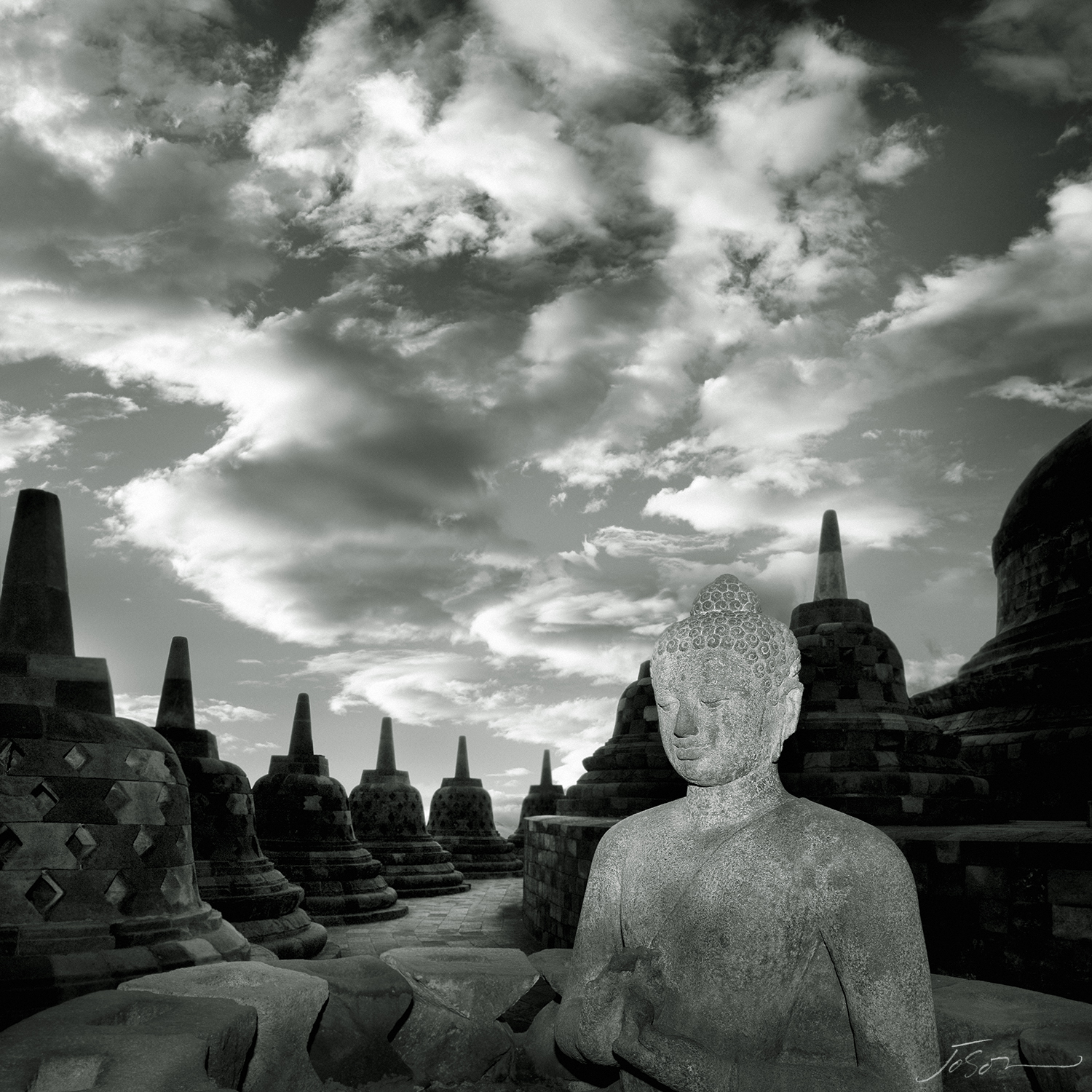 Statue of Buddha in Stupas at Borbudur Temple II, Yogyakarta, Indonesia.jpg