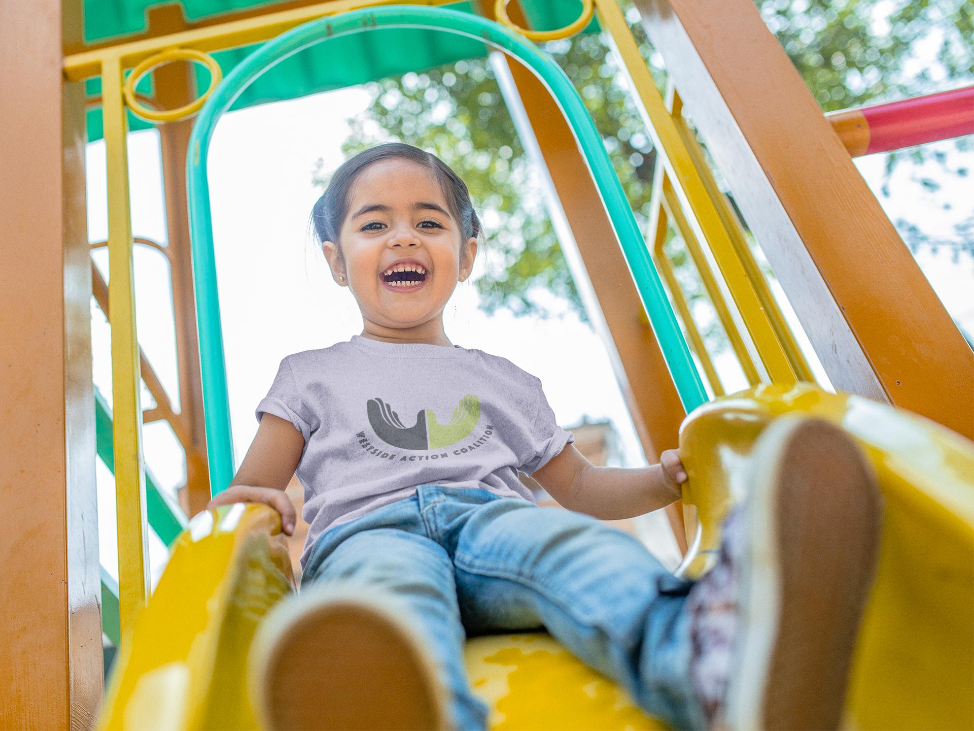 little-girl-riding-down-a-slide-t-shirt-mockup-a12108.png